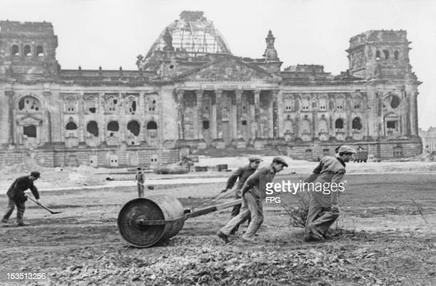 Workers flatten the wasteground in front of the ruined Reichstag in West Berlin in preparation for the 'Day of National Work' on May 1st circa 1947
