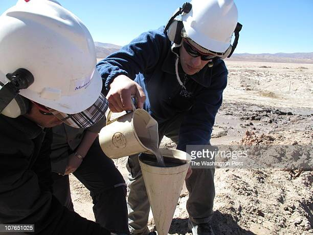 Workers for Exar the Argentine affiliate of Lithium Americas Corp take the brine extracted from an exploratory well The muck will be tested to find...