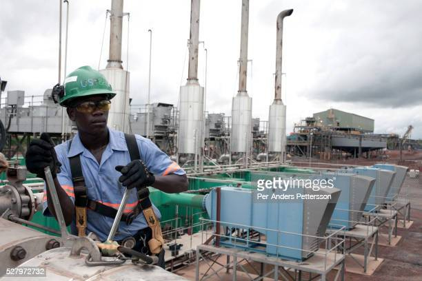 Workers for USPE Global service a power station for an iron oremine owned by London mining in Marampa Sierra Leone The power station runs on heavy...