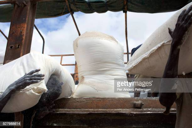 Workers for WFP World Food Program prepares food at their storage facility for the twice monthly food handout in the IFOR refugee camp on August 1...
