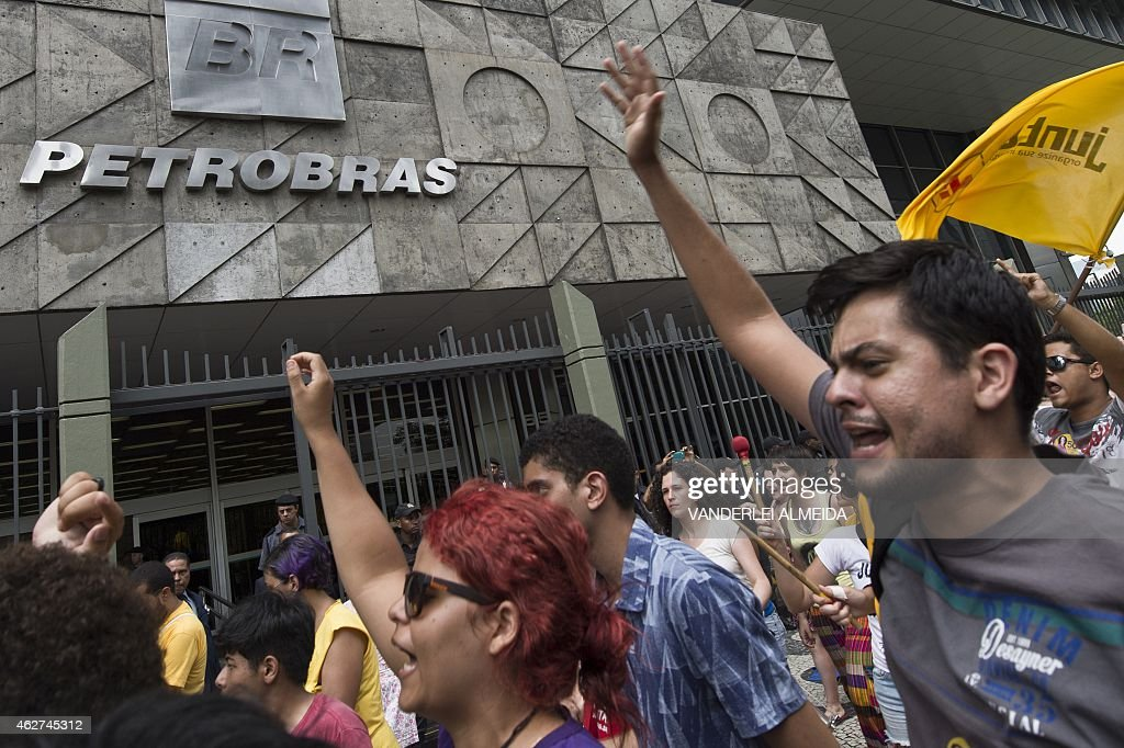 Workers from a company under contract for the Brazilian state-owned oil company Petrobras take part in a protest to demand the payment of three months of wages in arrears, in front of the Petrobras building in Rio de Janeiro, Brazil, on February 4, 2015. The chief executive of Brazilian oil giant Petrobras, Graca Foster, resigned along with the entire board of directors as the company reels from a massive corruption scandal, officials said.