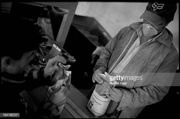 Workers from a local union pack the yerba mate ready to be sold in July, 2005 in Tamandua, Argentina. Only a few cooperatives sell their products...