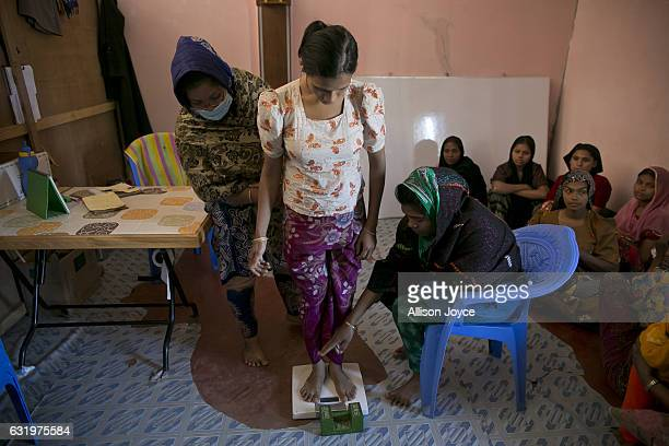 Workers from Action Contre La Faim in partnership with the World Food Program treat women at a nutrition center January 18 2017 in Coxs Bazar...