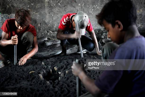 Workers from all ages work together without any safety equipment at a ship building yard beside the river Buriganga in Dhaka Bangladesh on March 9...