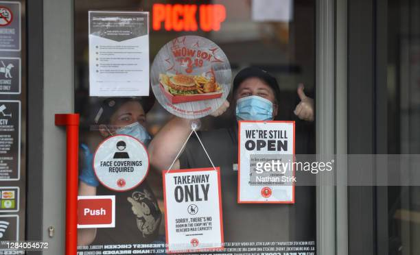 Workers from American fast food restaurant chain KFC, are seen as England enters a second national coronavirus lockdown today on November 05, 2020 in...