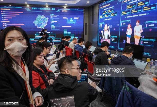 Workers from Chinese e-commerce giant JD.com track sales and trends for Singles Day in the data center control room at the company's headquarters...