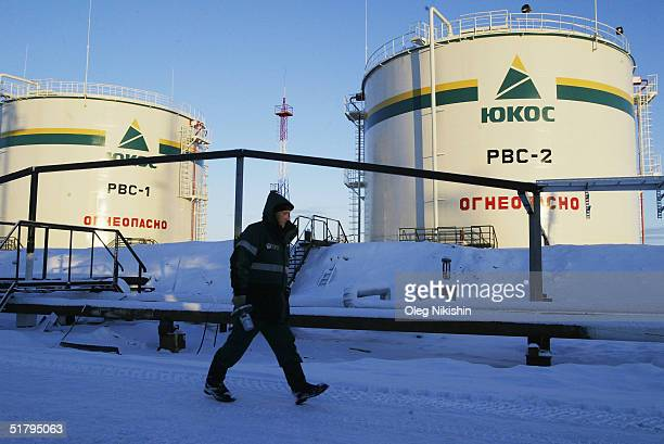Workers from contractors company of YUKOS giant oil company build at a new pumping station November 10, 2004 on the Ust-Balick oil field near...