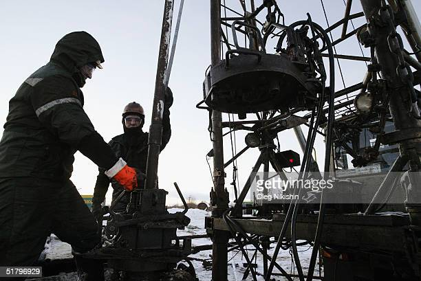SSC workers from contractors company of YUKOS giant oil company servicing an oil well on the Ust Balick oil field near Nefteyugansk West Siberia...