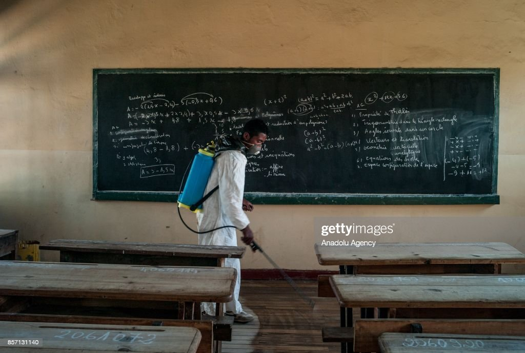 Workers from Department of Emergency and Response to Epidemics and Disasters (SURECA) within the Ministry of Health of Madagascar implement a desinsectisation in a public school in Antananarivo, Madagascar as plague spreads rapidly in cities across the country on October 3, 2017. Twenty people have died so far from plague in Madagascar while more than 100 other suspected cases have been registered across the country.