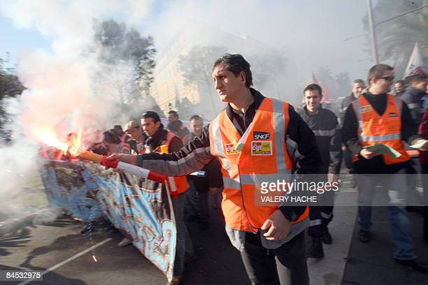 Workers from French staterun railway SNCF protest in the streets of Nice southern France on January 29 2009 during France's first major strike...