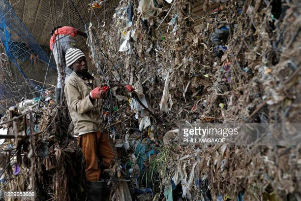 TOPSHOT Workers from Freshngo remove plastic deluge from litter trap nets and long line cables that was washed down under a bridge on the Clayville...