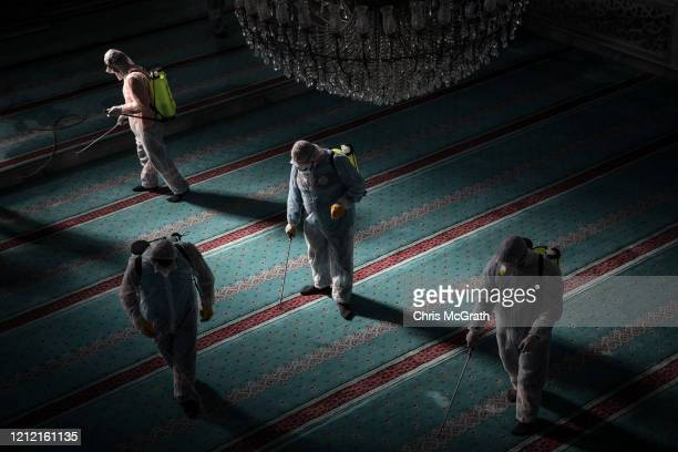 Workers from Istanbul Municipality disinfect a mosque to prevent the spread of the COVID-19, coronavirus ahead of Friday prayers on March 13, 2020 in...