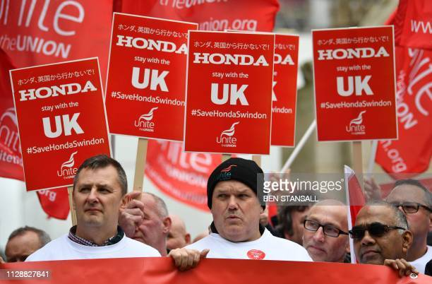 Workers from Japanese car maker Honda gather for a demonstration outside the Houses of Parliament in London on March 6 2019 to urge the government to...
