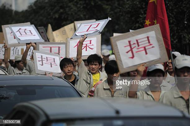 Workers from Japanese company Meiko Electronics Limited march with antiJapan banners during a protest against Japan's nationalizing of Diaoyu Islands...