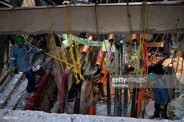 Workers from Mexico's Federal Electricity Commission or Commission Federal de Electricidad work at the site of the explosion at the Petroleos...