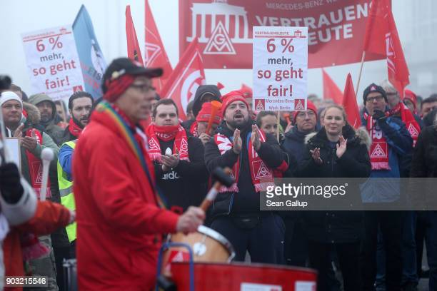 Workers from nearby Mercedes Benz and General Electric production plants participate in a warning strike in demands for better pay and more flexible...