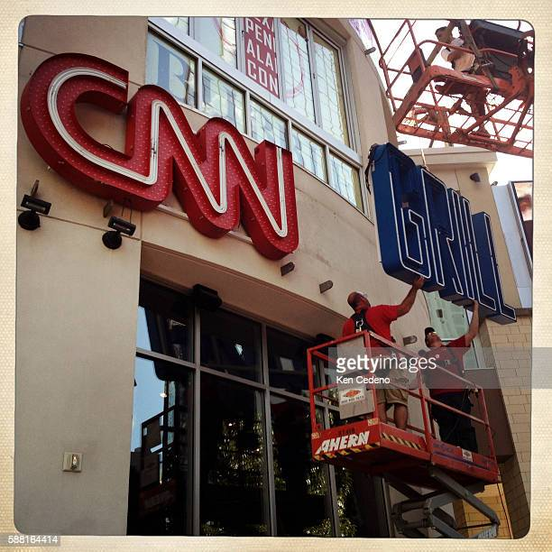 Workers from SignArt raise a portion of the CNN Grill sign at the EpiCentre in Charlotte NC August 31 2012 just days prior to the Democratic National...