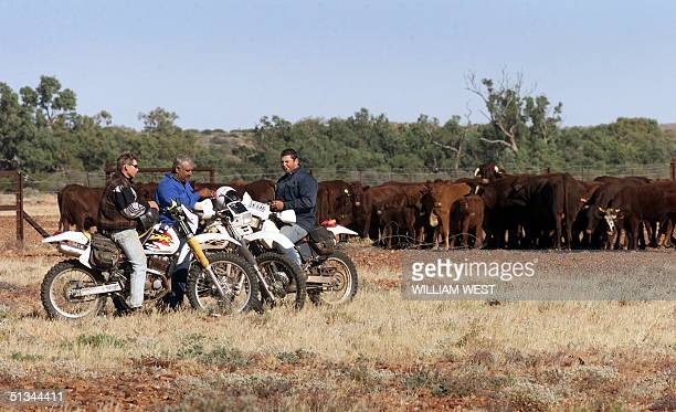 Workers from the Anna Creek cattle station take a break on the Oodnadatta Track in outback South Australia as they start the mustering of cattle by...