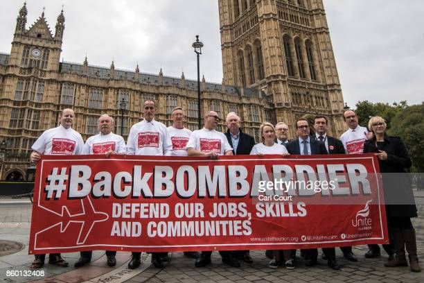 Workers from the Bombardier factory in Belfast and supporters hold a banner to highlight their situation as they meet MPs to urge for government...