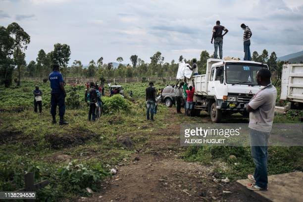 Workers from the cemetery in Goma, DR Congo, transport on April 20 the bodies of the 15 people found in Gisenyi, neighbouring Rwanda, after a boat...