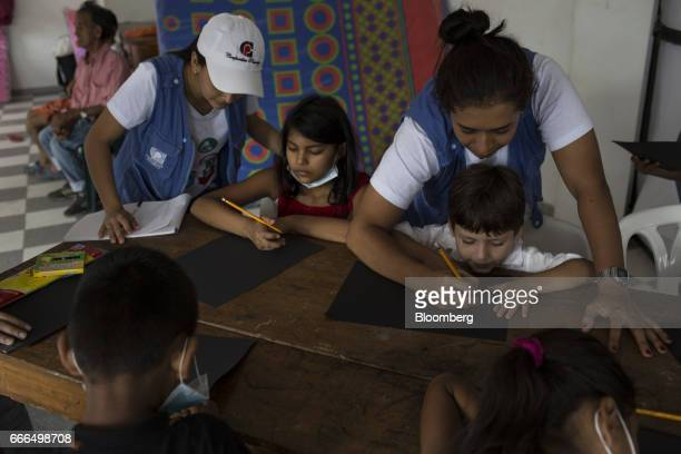 Workers from the Colombian Family Welfare Institute teach childern at an Indigenous Organization of Putumayo center after landslides in Mocoa...