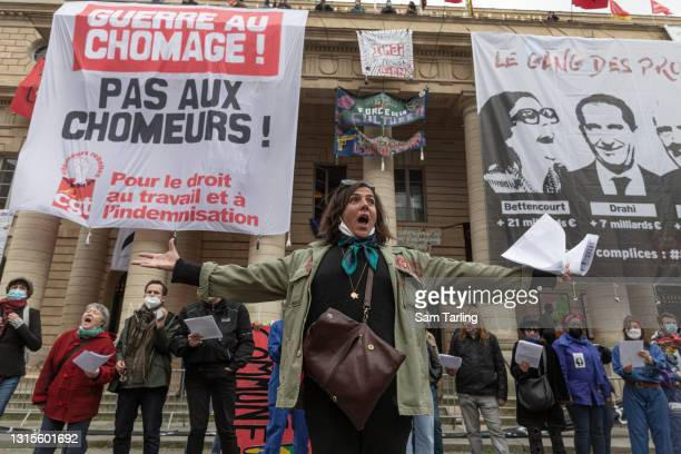 Workers from the cultural sector sing as they take part in International Labour Day protests on May 1, 2021 in Paris, France. Every year May Day is...