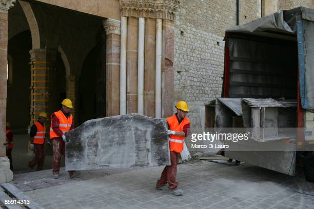 L'AQUILA ITALY APRIL 11 Workers from the Department of art preservation recover art pieces from the Collemaggio Cathedral on April 11 2009 in...