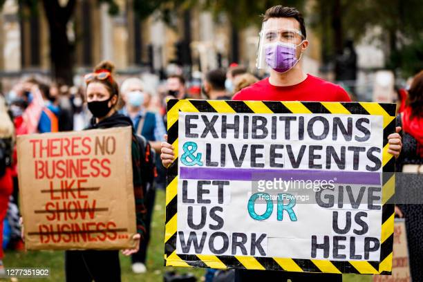 """Workers from the events industry gather during the #WeMakeEvents - """"Stand As One"""" silent protest at Parliament Square on September 29, 2020 in..."""