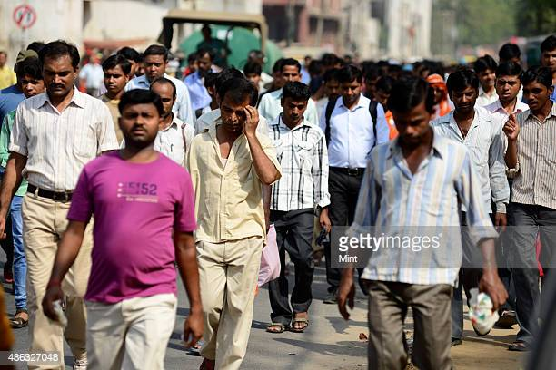 Workers from the garment industry coming out after work at Udyog Vihar in May 26 2013 in Gurgaon India There are around 2500 garment manufacturing...