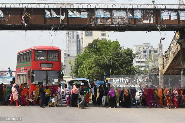 Workers from the garment sector block a road during a protest to demand payment of due wages in Dhaka on April 13 2020 Thousands of garment workers...