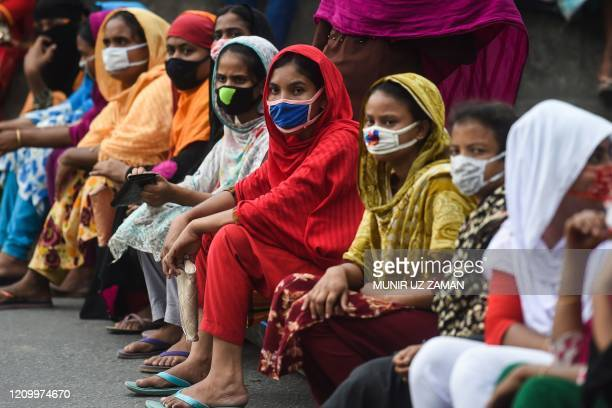 Workers from the garment sector block a road during a protest to demand payment of due wages in Dhaka on April 15 2020 Thousands of garment workers...