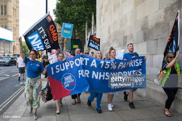 Workers from the grassroots NHSPay15 campaign march from Parliament to 10 Downing Street to present Matthew Tovey's petition signed by over 800,000...
