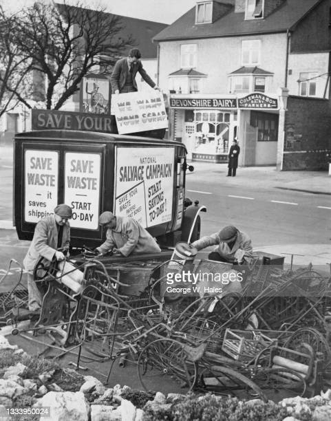 Workers from the Municipal Borough of Malden and Coombe Council collect disused laundry mangles, iron railings, bicycle frames and other scrap metals...