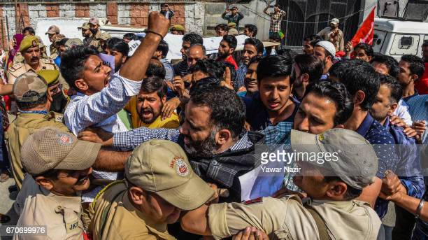 Workers from the National Conference a proIndia party Kashmiri's main opposition political party scuffle with Indian police after antiKashmir remarks...