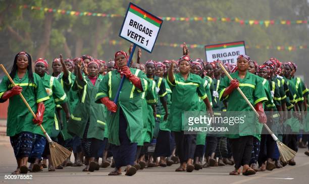 TOPSHOT Workers from the Ouagadougou city hall march during celebrations marking Burkina Faso's 55th anniversary of independence from France on...
