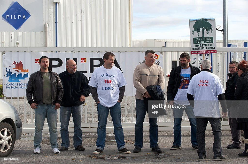 Workers from the Pilpa ice cream factory in Carcassonne, southern France, take part in surveillance rounds to stop the new factory owner from taking or dismantling factory equipment and machines, on December 27, 2012. 112 workers face the threat of being layed-off since July 2012 when the factory's owner sold the site to the R&R ice cream company and have struggled to keep the site and its jobs ever since. As the workers await court rulings pertaining to the factory site and its future, workers say they are being vigilant and have instituted rounds and a night guard to make sure R&R does not leave with the machines and equipment, thereby making it impossible for workers to consider continuing production at the site.
