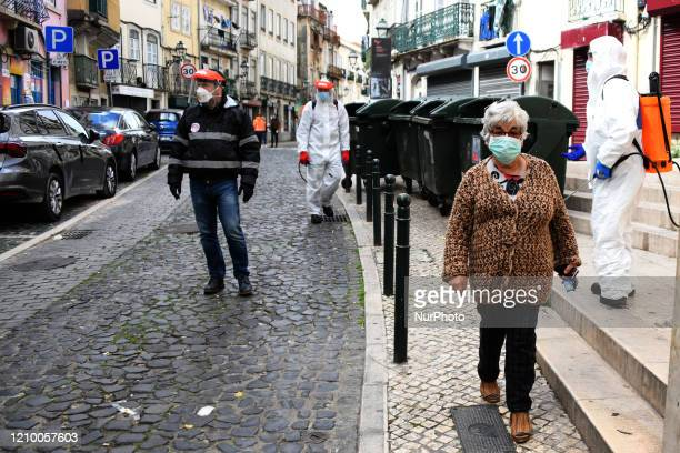 Workers from the Santa Maria Mayor Communal Council carry out cleaning work in the Martim Moniz sector in Lisbon on 15 April 2020 In Portugal 599...