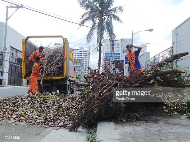 Workers from the Special Operations Emergency Responder continue their massive clearing and cleaning of uprooted trees in the streets of Quezon City...