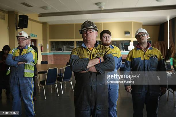 Workers from the Tata Steel plant listen to labour leader Jereym Corbyn speak to workers and union members at the Tata Sports Club on March 30, 2016...