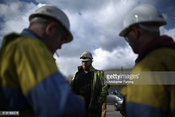 Workers from the Tata Steel plant wait for Labour leader Jeremy Corbyn to arrive and address them at the Tata Sports Club on March 30, 2016 in Port...