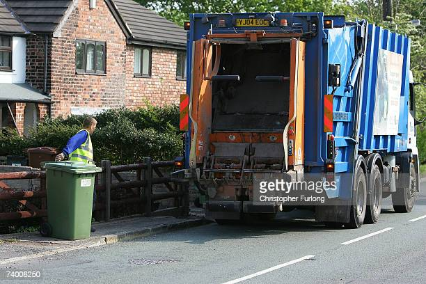 Workers from Vale Royal in Cheshire who already empty bins fortnightly empty wheelie bins on April 27 2007 in Northwich Cheshire Many councils in the...