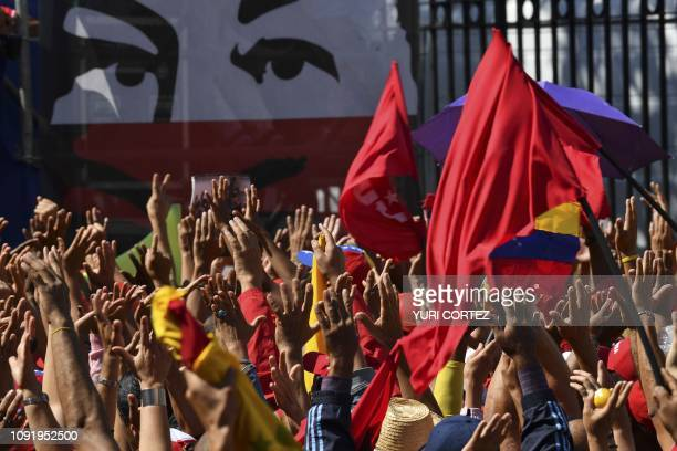 Workers from Venezuela's state oil company PDVSA participate in an antiimperialist march promoted by the government to support Venezuelan President...