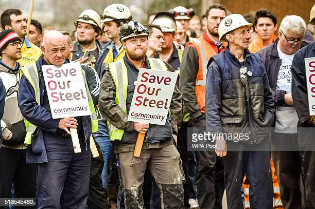 Workers gather at Tata Steel as business secretary Sajid Javid leaves Tata steel works on April 1, 2016 in Port Talbot, Wales. Owners Tata Steel have...