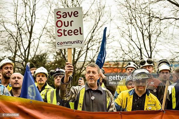 Workers gather at Tata Steel as business secretary Sajid Javid leaves Tata steel works on April 1 2016 in Port Talbot Wales Owners Tata Steel have...