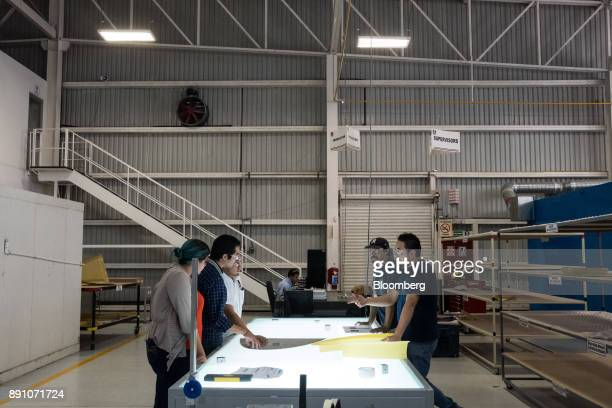 Workers gather for a meeting at the Tighitco Inc manufacturing facility in San Luis Potosi Mexico on Thursday Nov 16 2017 With 312 registered...