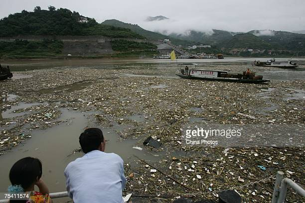 Workers gather rubbish on the Yangtze River after rain storms on July 13 2007 in Chongqing Municipality China Torrential rains hit over 24 provinces...
