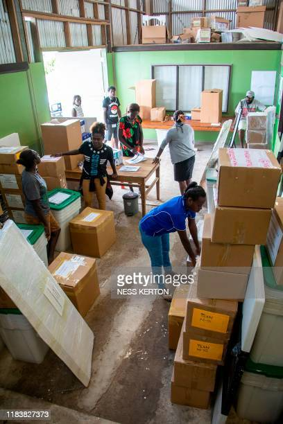 Workers get a polling station ready ahead of an historical independence vote in the capital Buka on November 22 2019 The resourcerich Pacific...