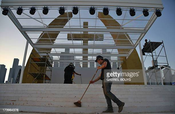 """Workers give the finishing touches to a stage constructed for a papal mass and youth vigil to be held on """"Campus Fidei"""", a 300-hectare vacant lot in..."""