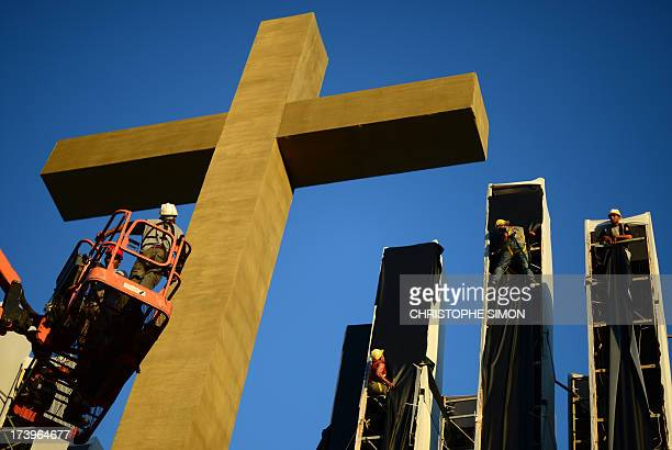 """Workers give the finishing touches to the stage constructed for a papal mass and youth vigil to be held on """"Campus Fidei"""", a 300-hectare vacant lot..."""