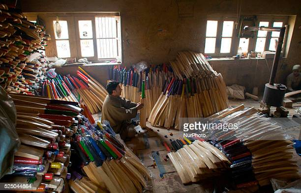 Workers gives finishing touches to cricket bat in a bat factory on February 11 2015 in Halmullah 50 km south of Srinagar the summer capital of Indian...